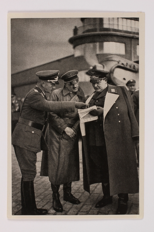 2012.68.7 front Cigarette card phot of Hitler and Goering reviewing papers