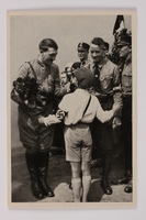 2012.68.8 front Cigarette card photo of a smiling Hitler with roses and a Hitler Youth member  Click to enlarge