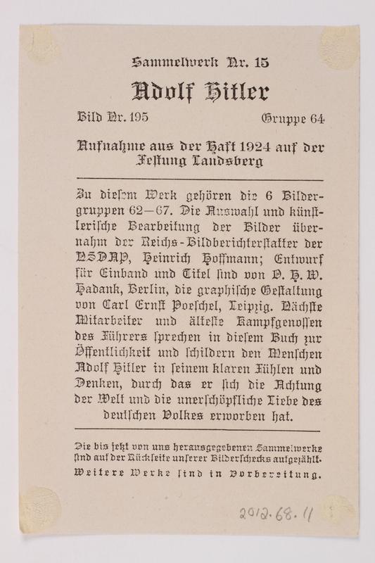 2012.68.11 back Cigarette card photo of Hitler reading the newspaper