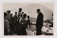 2012.68.16 front Cigarette card photo of Hitler chatting with a Hitler Youth group  Click to enlarge