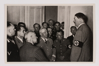 2012.68.18 front Cigarette card photo of Hitler with a group of Nazi Party officials  Click to enlarge