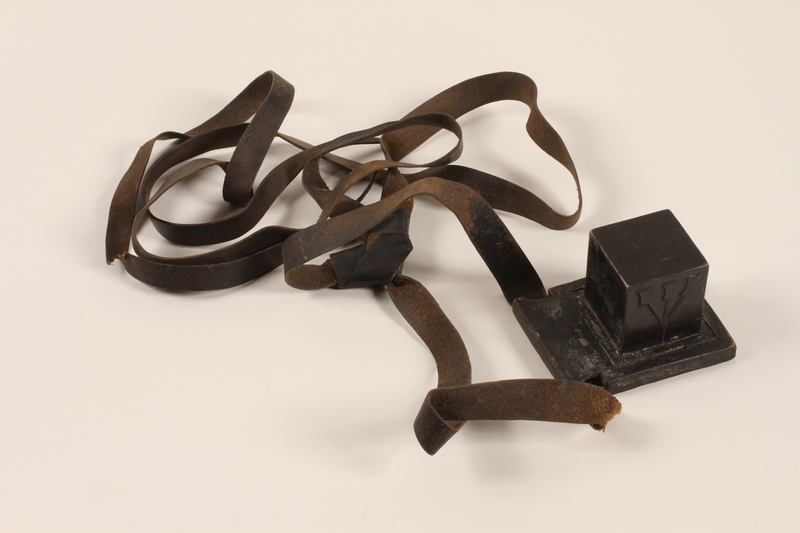 2012.72.11 a front Tefillin set with an extra strap used by a Jewish immigrant