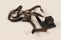 2012.72.11 a front Tefillin set with an extra strap used by a Jewish immigrant  Click to enlarge