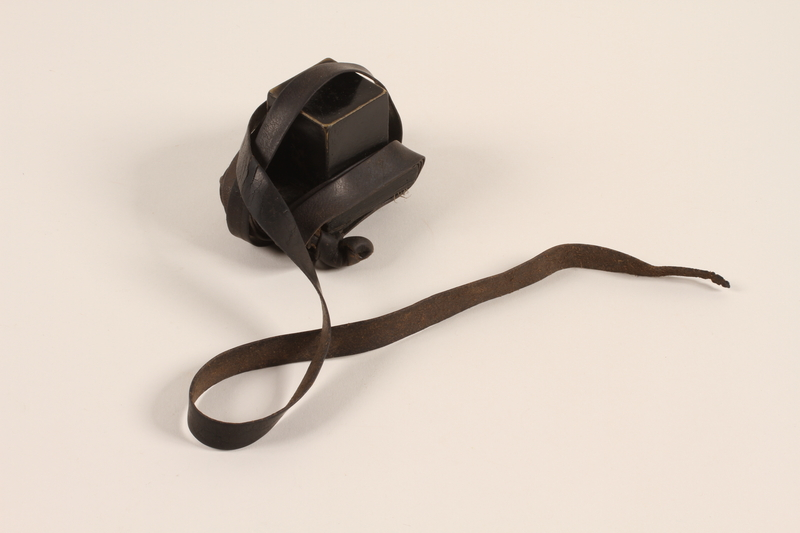 2012.72.11 b front Tefillin set with an extra strap used by a Jewish immigrant
