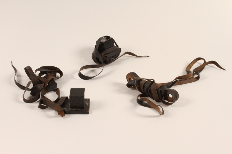2012.72.11 a-c front Tefillin set with an extra strap used by a Jewish immigrant