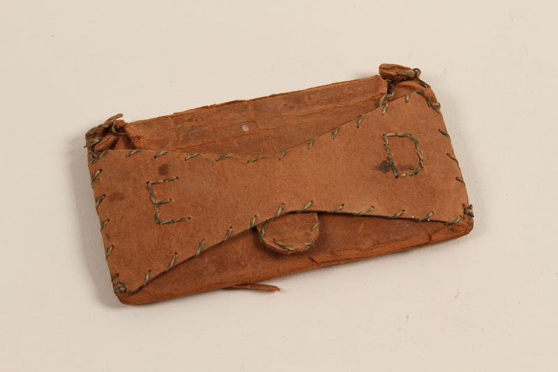 2012.310.1_b front Wooden comb and handmade paper case given to a prisoner by a friend in Kaiserwald concentration camp