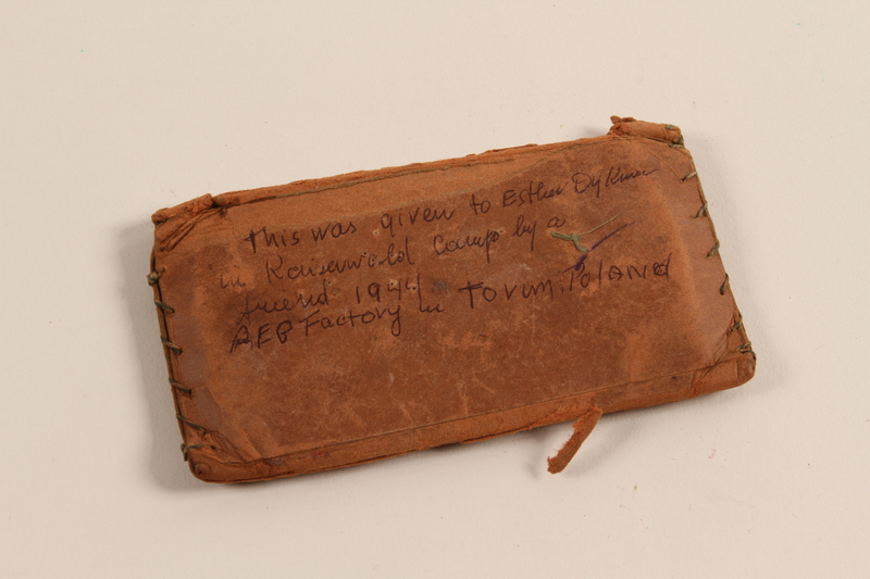 2012.310.1_a back Wooden comb and handmade paper case given to a prisoner by a friend in Kaiserwald concentration camp