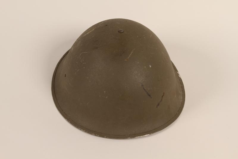 2012.229.1 front Brodie pattern MK II green steel helmet worn by a Belgian officer