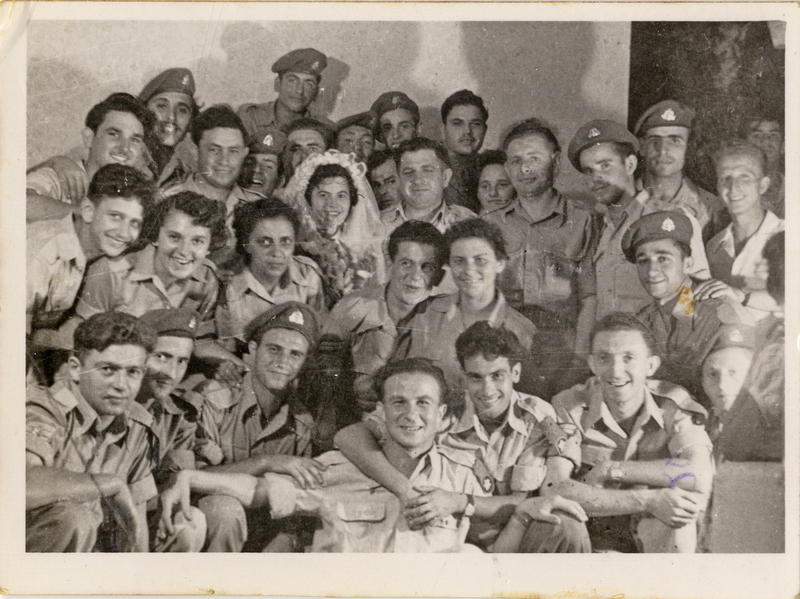 First Sargeant Shmuel Kaufman (first frim left in the first row) and his future wife Corporal Miriam Braun (first from left in second row) at a frien'd wedding party. Shmuel and Miriam Kaufman Collection