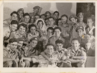 First Sargeant Shmuel Kaufman (first frim left in the first row) and his future wife Corporal Miriam Braun (first from left in second row) at a frien'd wedding party. Shmuel and Miriam Kaufman Collection  Click to enlarge