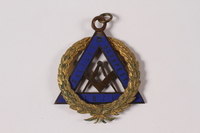 2010.81.9 front Gold and blue enamel Masonic medal with the compass and square emblem owned by a Jewish Hungarian emigre  Click to enlarge