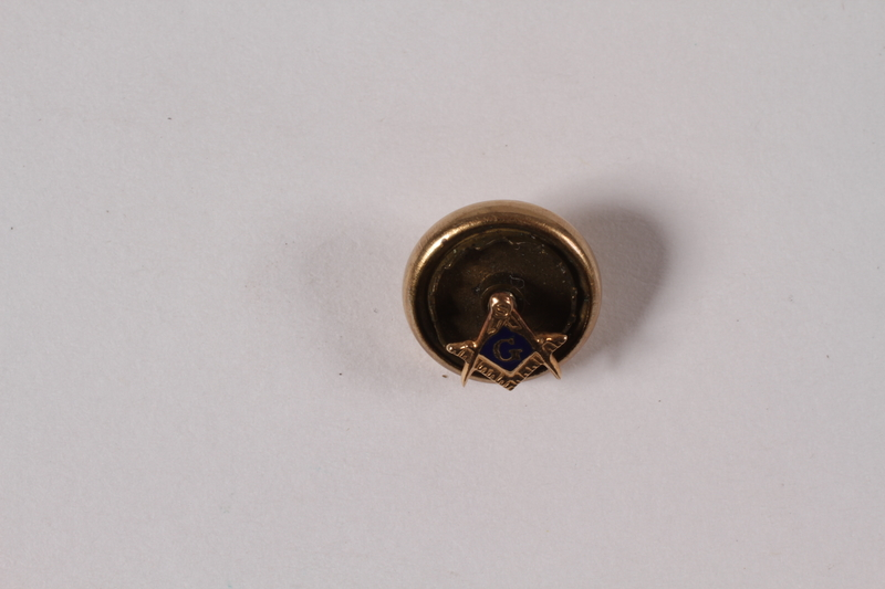 2010.81.10 front Masonic tie pin with a gold compass and square emblem owned by a Hungarian Jewish emigre