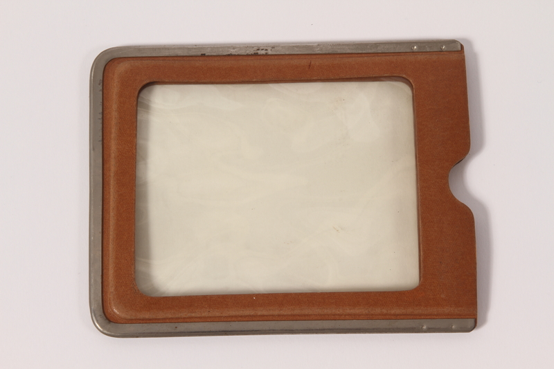 2010.81.11 front Plastic identification badge holder used by a Hungarian Jewish emigre