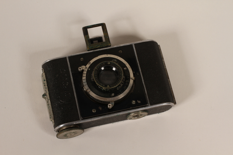 2012.187.2_a front Korelle 3x4 camera and a brown leather pouch used by a member of the Czech resistance