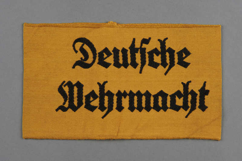 2011.425.2 front Yellow civilian Deutsche Wehrmacht armband acquired by a US soldier