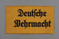 2011.425.2 front Yellow civilian Deutsche Wehrmacht armband acquired by a US soldier  Click to enlarge