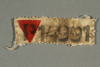 2011.431.2 front Red triangle badge with the letter P worn by a concentration camp inmate  Click to enlarge