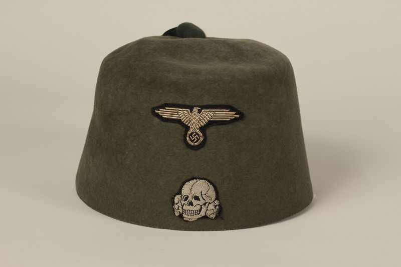 1991.196.1 front Waffen SS green fez given to a US officer by his soldiers after the liberation of Dachau concentration camp