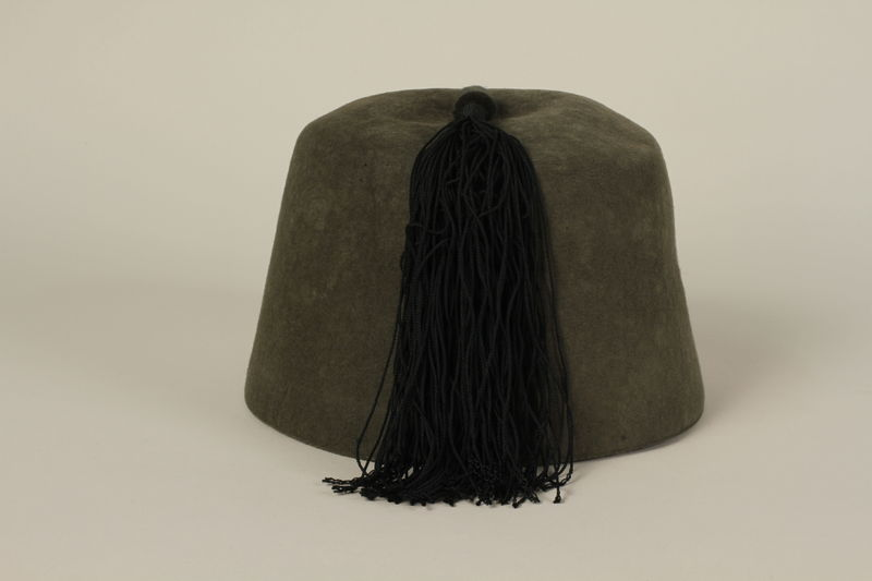 1991.196.1 back Waffen SS green fez given to a US officer by his soldiers after the liberation of Dachau concentration camp