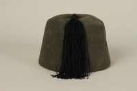 1991.196.1 back Waffen SS green fez given to a US officer by his soldiers after the liberation of Dachau concentration camp  Click to enlarge