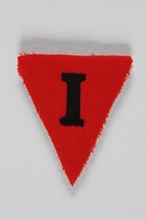 1991.198.10 front Unused red triangle concentration camp prisoner patch with a black letter I found by US forces  Click to enlarge