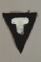 1991.198.12 front Unused black triangle concentration camp patch with a white letter T found by US forces  Click to enlarge