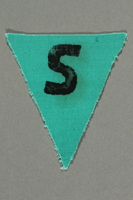 1991.198.6 front Unused green triangle concentration camp prisoner patch with a black letter S found by US forces  Click to enlarge