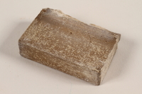 1991.215.2 front Unused brown soap bar imprinted RIF 0667  Click to enlarge