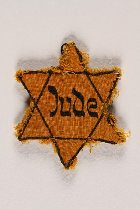1988.64.1.4 front Star of David badge with Jude printed in the center