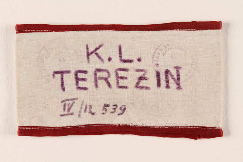 1988.64.1.6 front Armband identifying a Jewish inmate of Theresienstadt