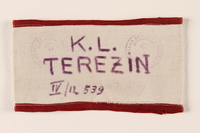 1988.64.1.6 front Armband identifying a Jewish inmate of Theresienstadt  Click to enlarge