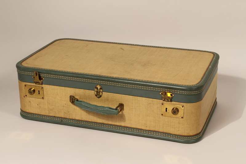 2012.261.3 a closed Yellow and green suitcase with key used by a German Jewish girl