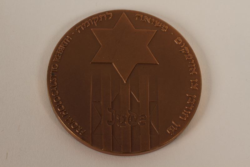 2012.313.3 back From Holocaust to Rebirth commemorative bronze medal acquired by a Polish Jewish survivor of several concentration camps