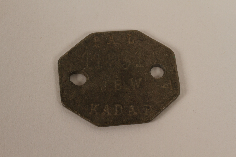 2004.616.3 front Military ID tag issued to identify a Jewish volunteer in the British Army