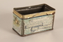 Painted tin container base owned by a German Jewish refugee