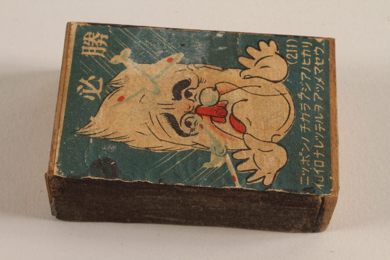 2010.240.8 front Japanese propaganda matchbox with a caricature of FDR acquired postwar by a German Jewish refugee