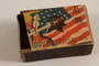 Japanese propaganda matchbox with a Japanese sword piercing the US flag acquired postwar by a German Jewish refugee