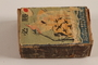 Japanese propaganda matchbox with Japanese planes flying over a sinking ship with a US flag acquired postwar by a German Jewish refugee