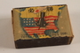 Japanese propaganda matchbox with a bomb exploding in the center of the US acquired postwar by a German Jewish refugee