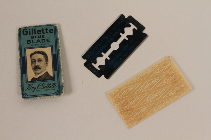 2010.240.20_a-c front Gillette razor blade, cover and wrapper featuring King C. Gillette brought to Shanghai by an Austrian Jewish refugee