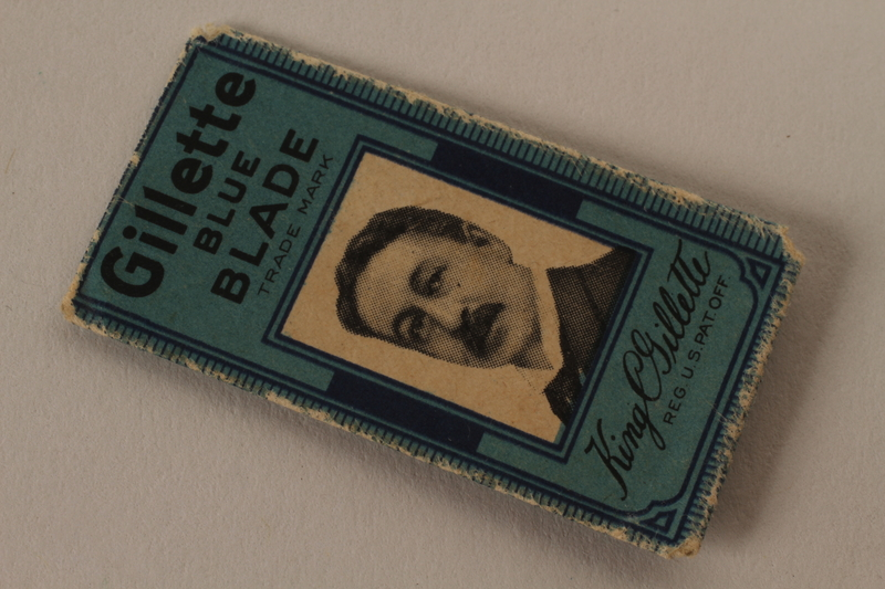 2010.240.20_c front Gillette razor blade, cover and wrapper featuring King C. Gillette brought to Shanghai by an Austrian Jewish refugee