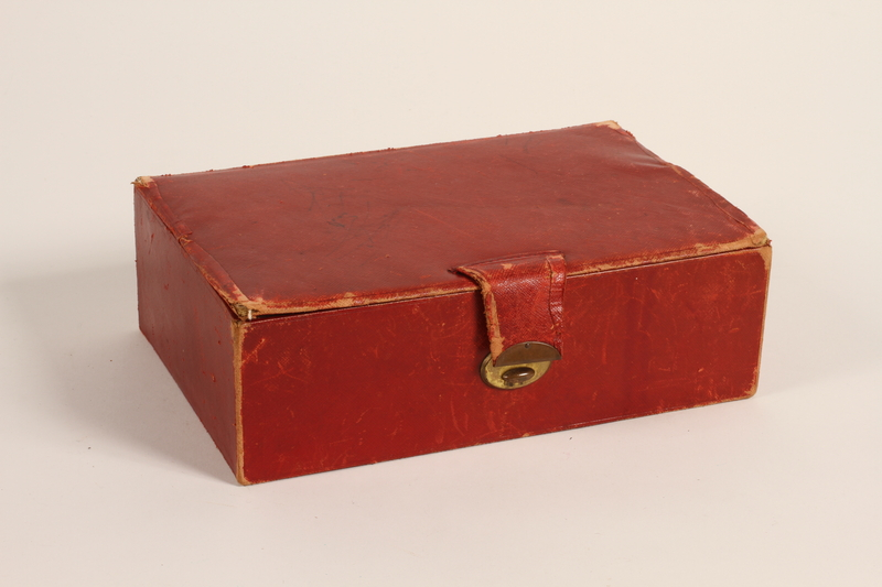 2012.342.2 closed Red leather sewing box recovered postwar by a Czech Jewish woman