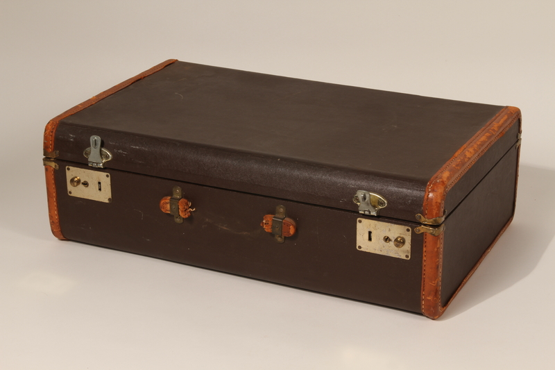 2012.343.2 front Brown cloth and leather trimmed suitcase used by a young Polish Jewish boy