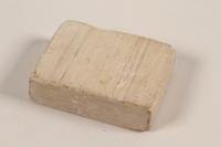 2005.301.1 front Soap from Bergen-Belsen concentration camp  Click to enlarge