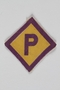 Forced labor badge, yellow with a purple P, to identify a Polish forced laborer