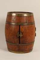 2012.355.1 front Small wooden barrel with a door from the home where a Jewish child lived in hiding  Click to enlarge