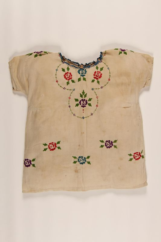 2002.54.2 front Embroidered dress worn by a Polish Jewish girl in hiding