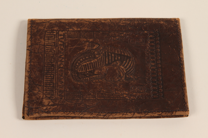 2002.105.2 front Leather wallet with embossed images of Egyptian pharaohs acquired by a Jewish medical officer, 2nd Polish Corps