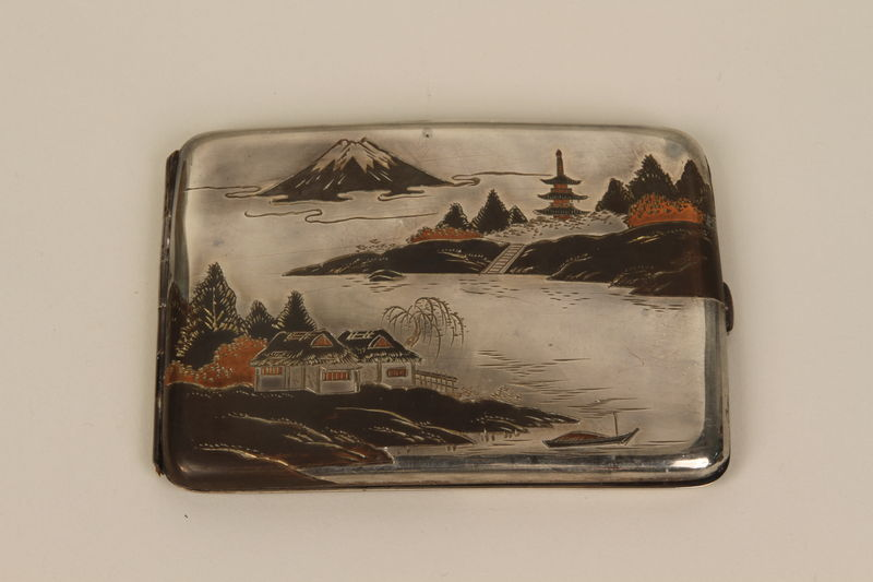 2001.283.4 front Sterling silver cigarette case with an etched Japanese landscape
