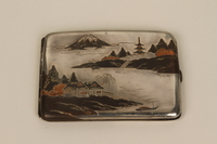 2001.283.4 front Sterling silver cigarette case with an etched Japanese landscape  Click to enlarge
